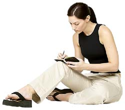 Picture of a woman writing a journal keeping track of her liver cleanse.