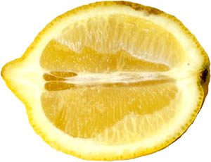 Add a bit of lemon to your liver detox diet. Picture of half a lemon.