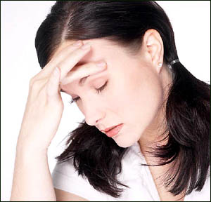 Fatigue can be a sign that you need a fatty liver diet: Photo of tired woman.