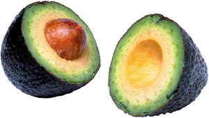 Avocados cut in half. Learn why avocados are great for liver cleansing.