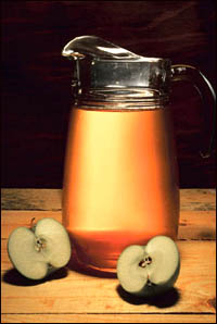 Organic apple juice is a vital part of the liver flush. Picutre of a jug of apple juice.