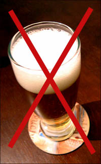 Stop drinking alcohol: Picture of a beer glass with a red cross over it.