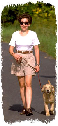 Woman doing exercise by walking the dog.