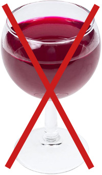 No drinking if you have a fatty liver. Picture of a glass of wine.